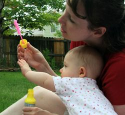 Blowing bubbles with mommy